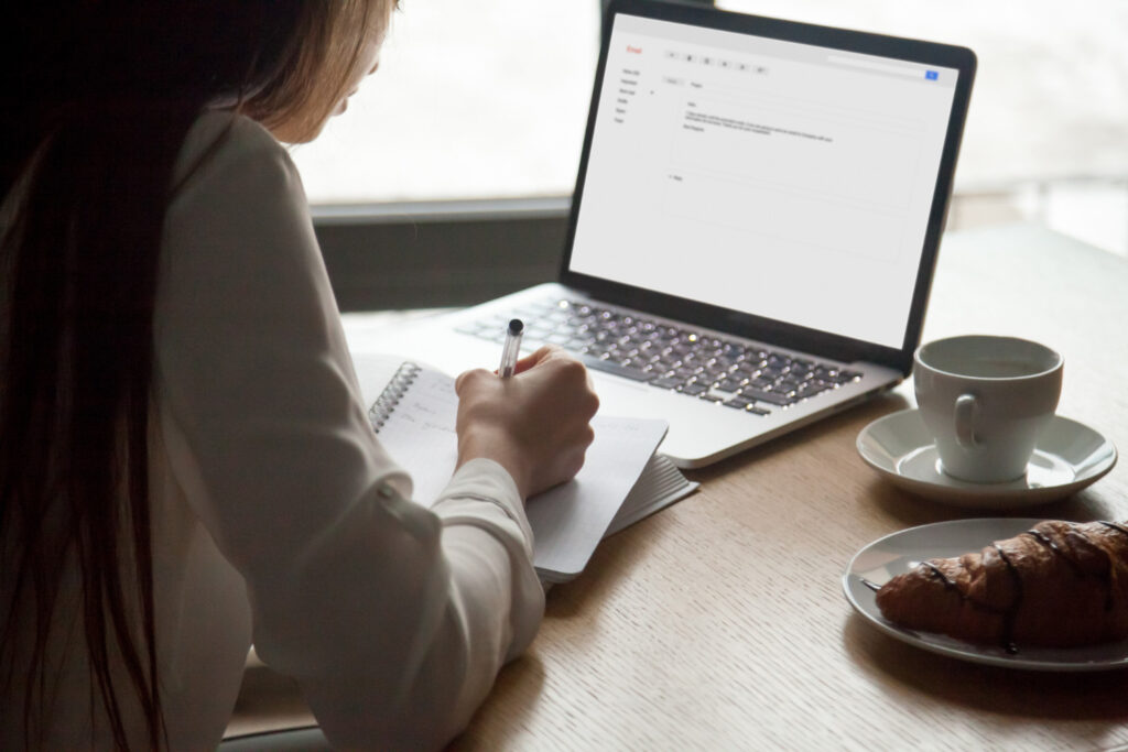 Woman Making Notes Reading Email Letter